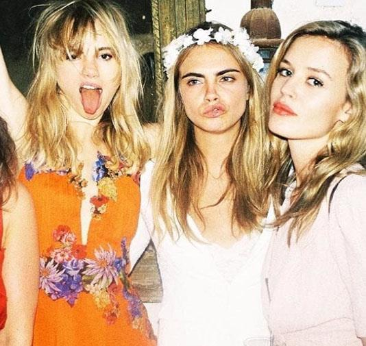 Cara Delevingne tapped into the all white bridesmaid trend in a Chanel gown for her sister Poppy's May 2014 wedding.