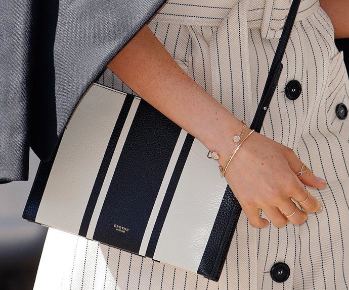 Meghan often totes a classic envelope style handbag. This one is buy Aussie label, Oroton.