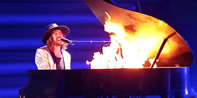 In 2015, Austria brought the heat to the competition when Dominic Muhrer dramatically sent the piano up in flames mid-song.