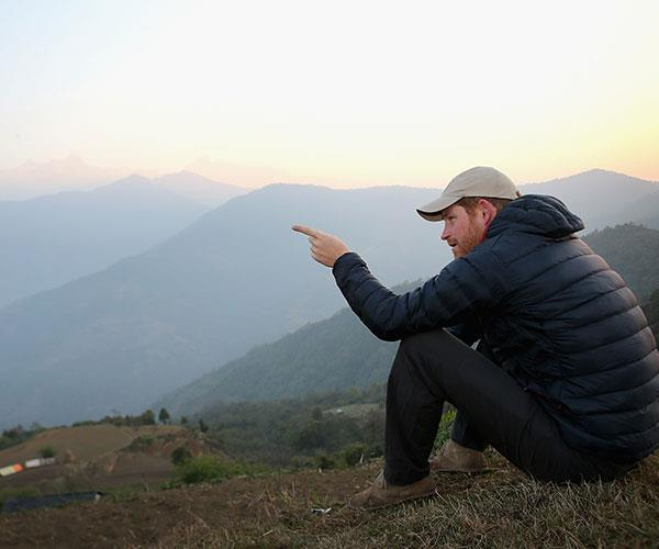 Simply magical! Chris captures Prince Harry watching the sun rise after spending the night in the Himalayan hilltop village of Leorani.