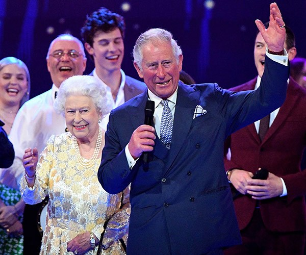 "Prince Charles raises his hand for ""Mummy""."