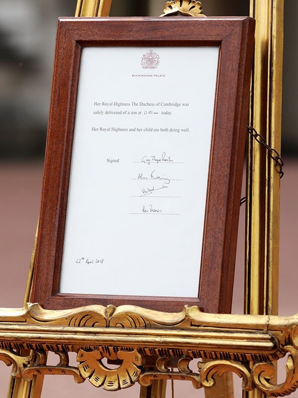 The royal notice that was placed outside Buckingham Palace to announce Prince Louis' birth in 2018. *(Image: Getty)*