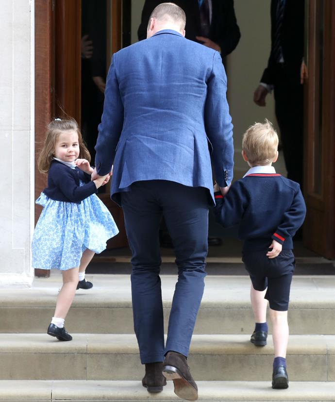 It was all business for the young royal who gripped tightly onto his daddy's hand.