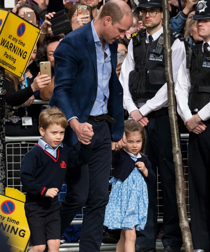 Both George and Charlotte gripped tightly onto their dad's hand as they made their way toward the hospital entrance.