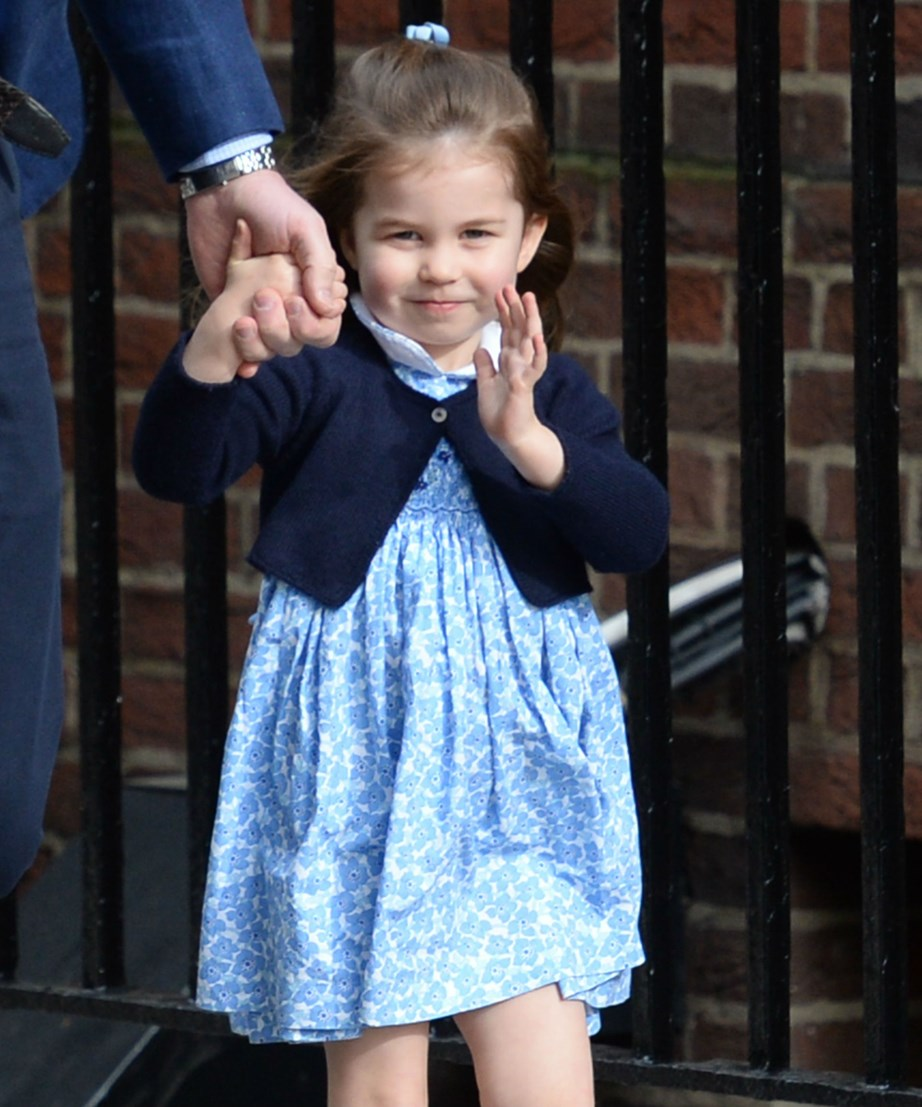 She's already perfected her royal wave! Princess Charlotte waves at the cameras as she goes to visit her newborn brother for the first time at the hospital. *(Image: Getty)*