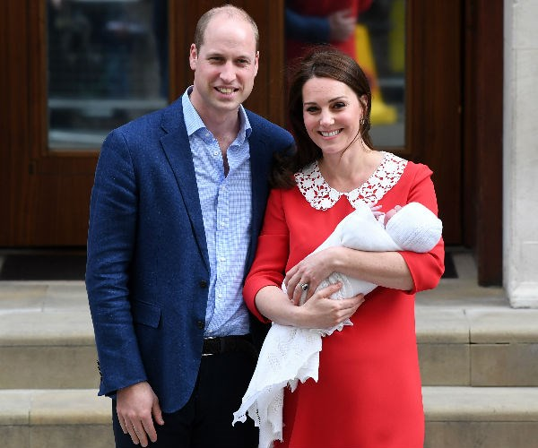 The new parents absolutely beamed as they showed off their new arrival on the stairs of the Lindo Wing at St Mary's Hospital in Paddington, London.