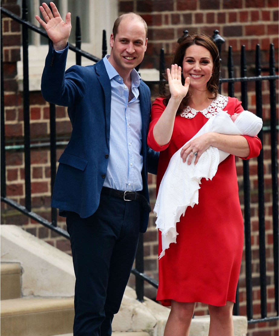 Prince William and Kate pose on the steps of St Mary's Hospital with their new baby boy, just hours after he was born. *(Image: Getty)*