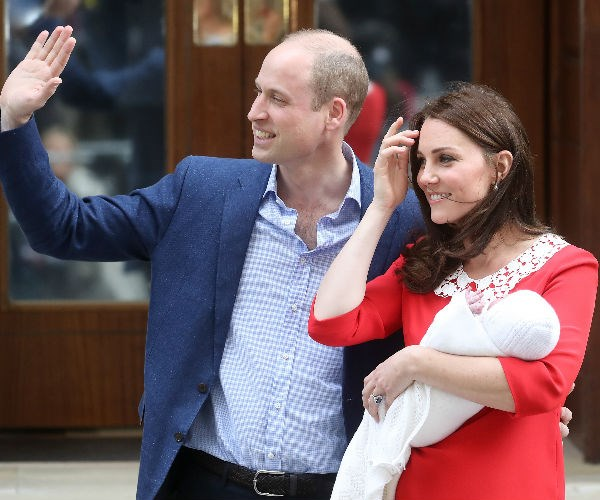 Kate, 36, and Wills, 35, were happy to pose for photographs with their little one but politely declined to answer any questions.