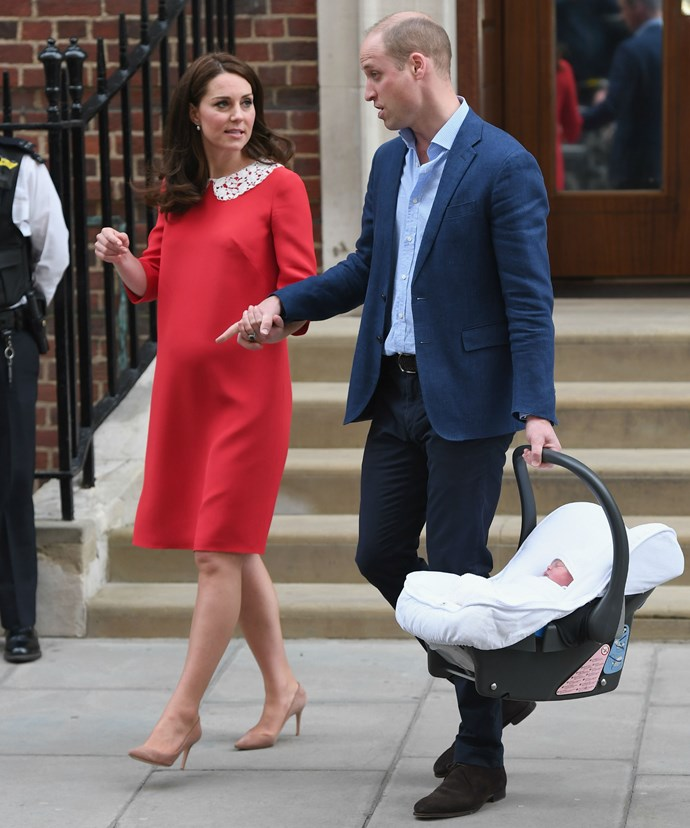 William took to the driver's seat of a waiting car while Kate sat in the backseat with her precious new bundle of joy.