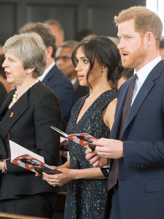 Meghan and Harry were seated next to Prime Minister Teresa May.