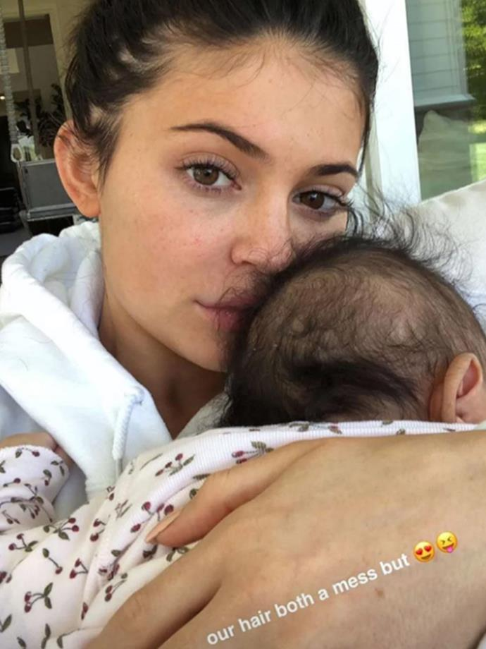 It's not every day you see Kylie Jenner without a full-face of make-up. However, the new mum, 20, shared multiple videos and photos of herself with her baby girl on Instagram Story and Snapchat from her home in Calabasas without a scrape of make-up on her famous complexion.