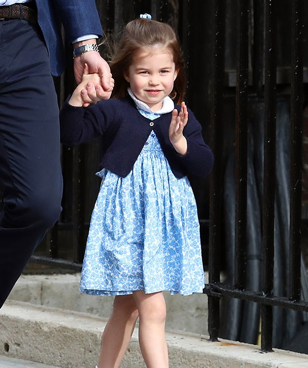 Princess perfection: Charlotte shows off her royal wave.