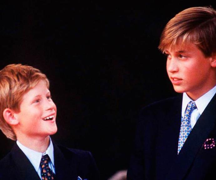Looking to get a laugh out of his big brother, Harry stares up at William at a VJ Day celebration in 1995.