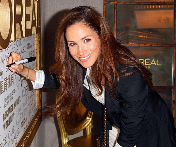You won't see Meghan signing her autograph anymore.