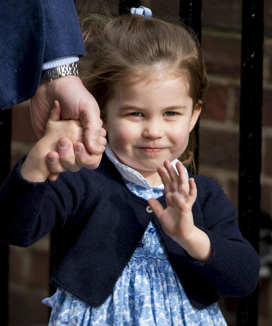 She has the royal wave down pat!
