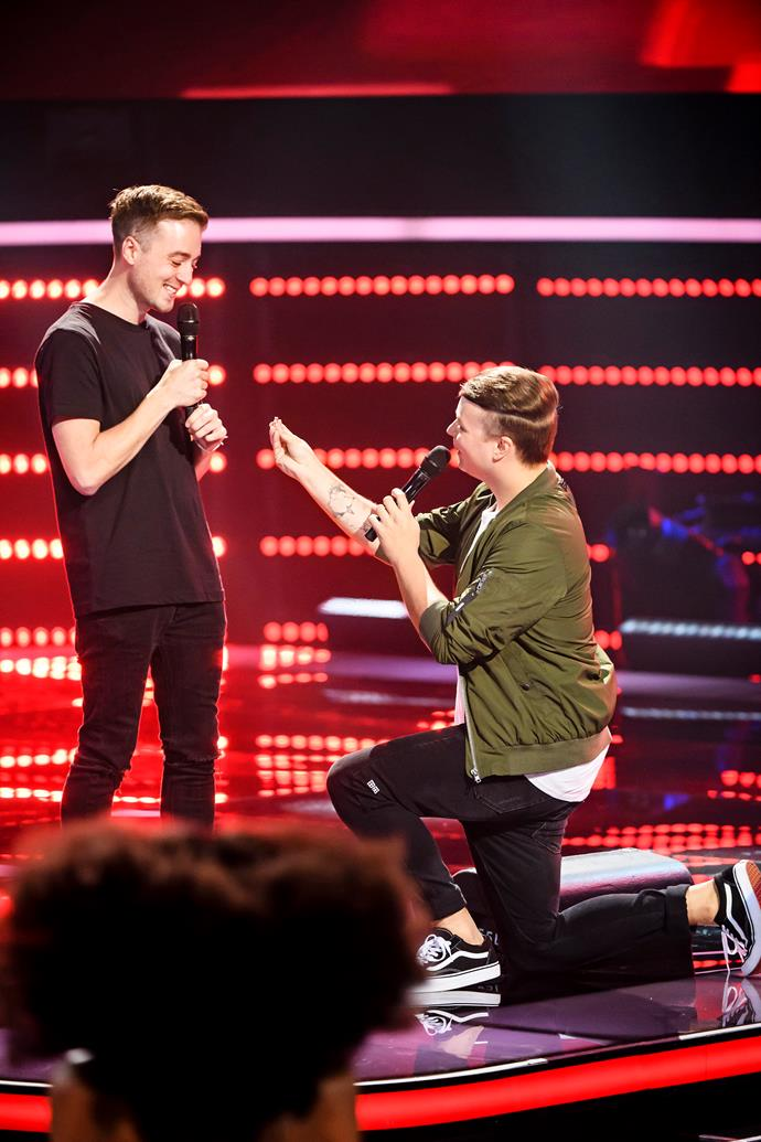 The Voice contestant Nathan pops the questions to Mitchell.