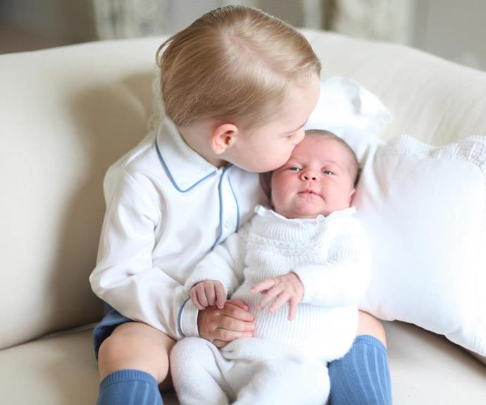 Same-same but different: Prince George posed with his new sister Princess Charlotte for her first portrait taken by mum Duchess Catherine in 2015.