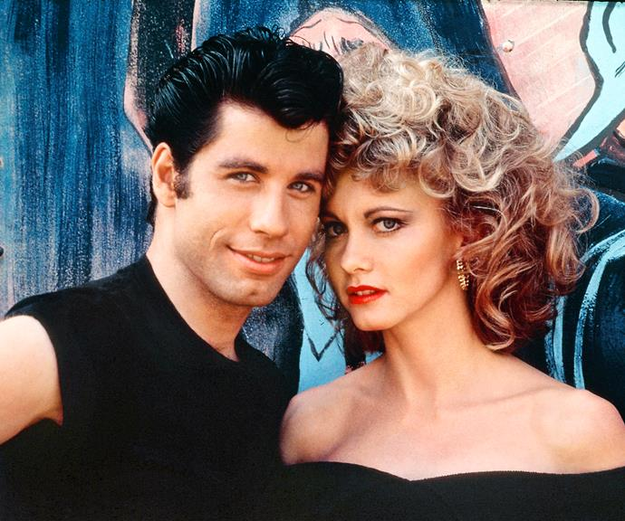 Olivia and John as star-crossed lovers Sandy and Danny in *Grease*.