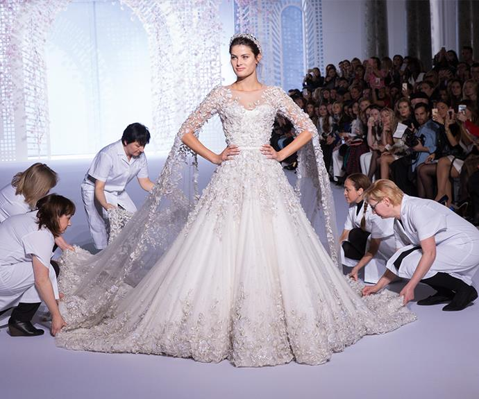 Reports suggest Meghan Markle has chosen a hand-beaded design similar to this stunning Ralph & Russo wedding dress.
