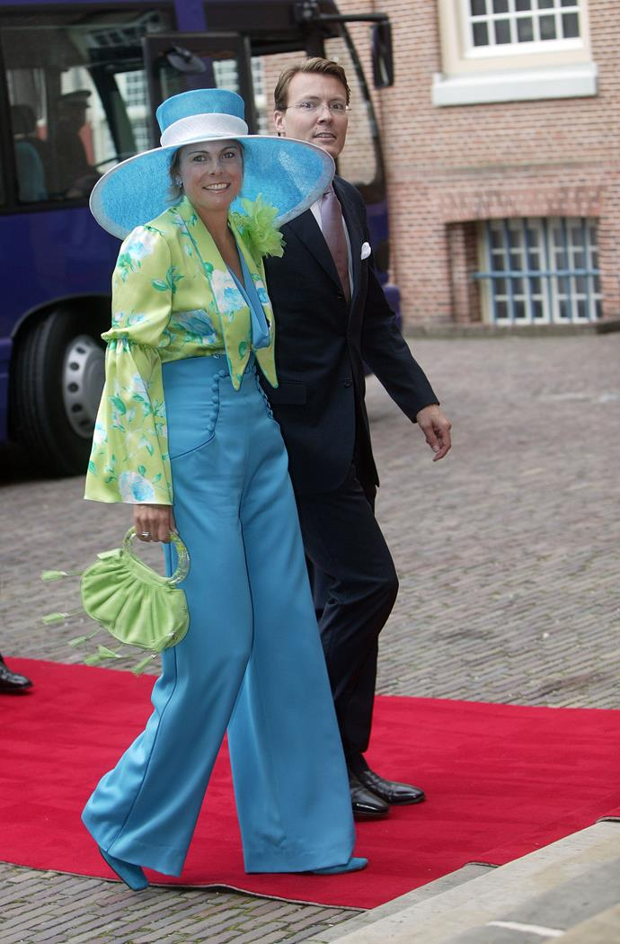 The blue high-waisted pants, flowing top and oversized hat might be a tad too much on Princess Laurentien.