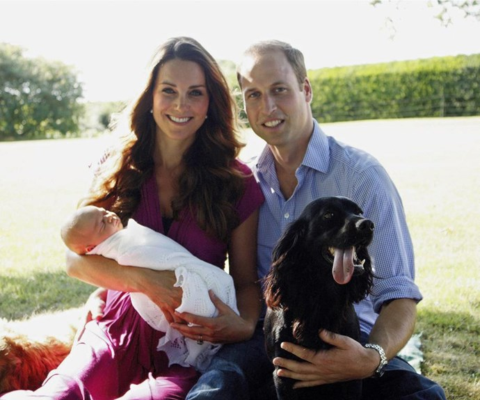 This photo was set in the Middletons' sun-soaked back garden in Berkshire. Kate's dad Michael captured an intimate moment of a sleeping George cradled in his mum's arms with William by their side. Also making the shot were the family pets Lupo and Tilly (far left).