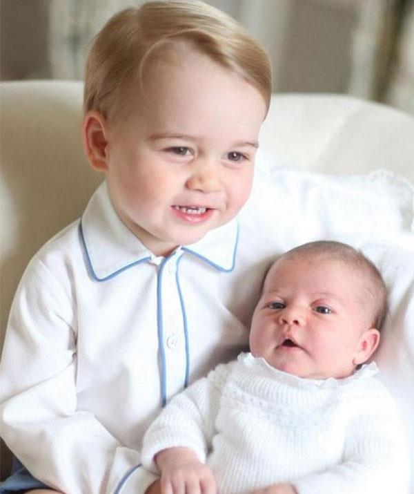 Proud big brother Prince George bonds with his baby sister at Anmer Hall in Norfolk.