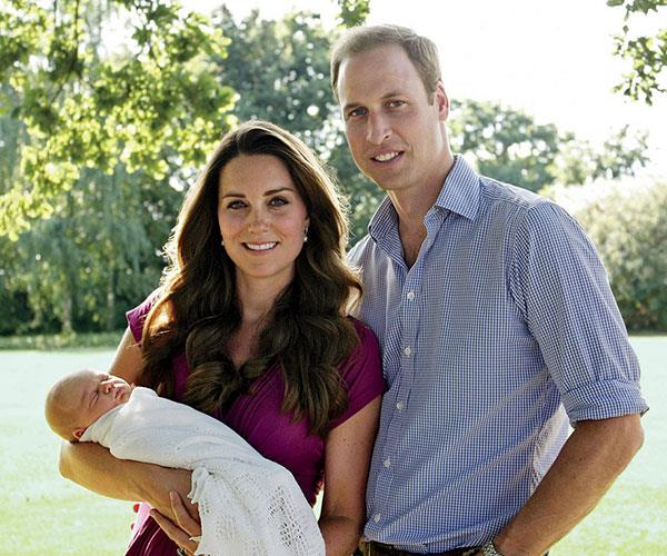 The proud parents pose in the backyard with their first-born, Prince George.