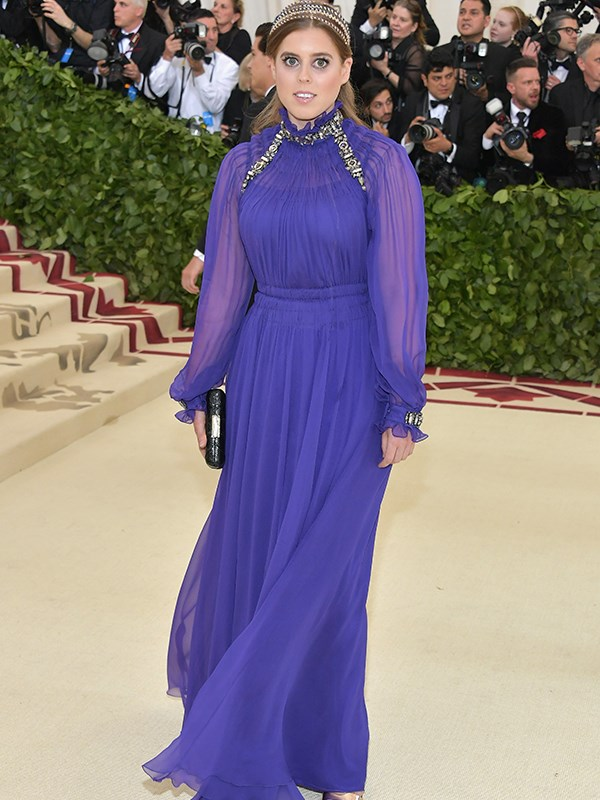 Princess Beatrice of York is regal in a sheer purple gown.