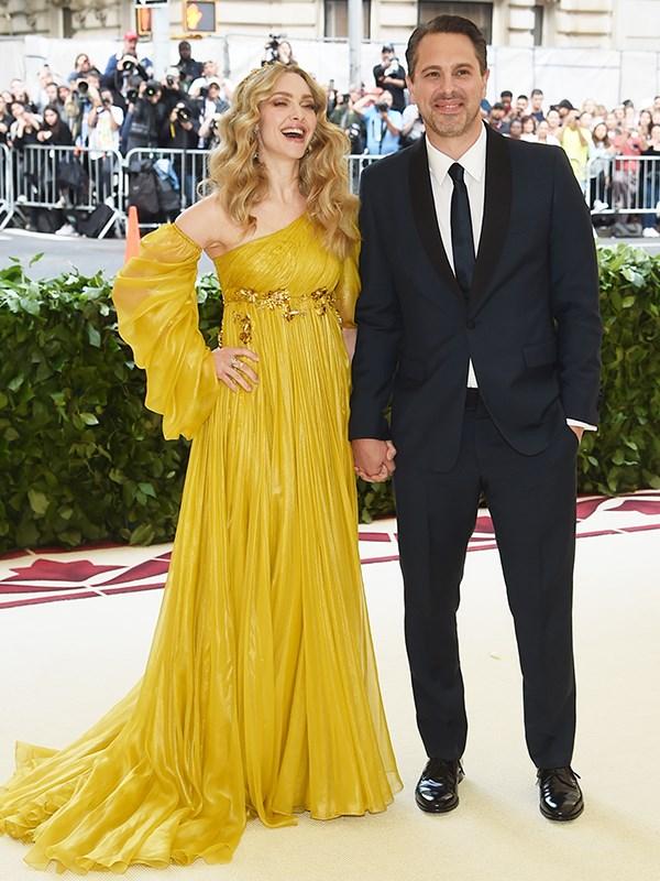 Dressed like an angel Amanda Seyfried arrives with Thomas Sadoski.