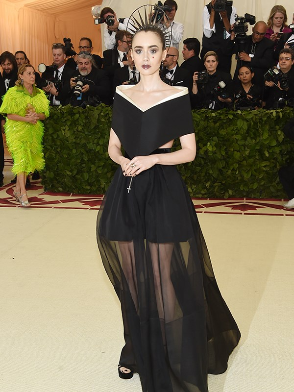 Lilly Collins donned a halo tiara and a sheer black dress.