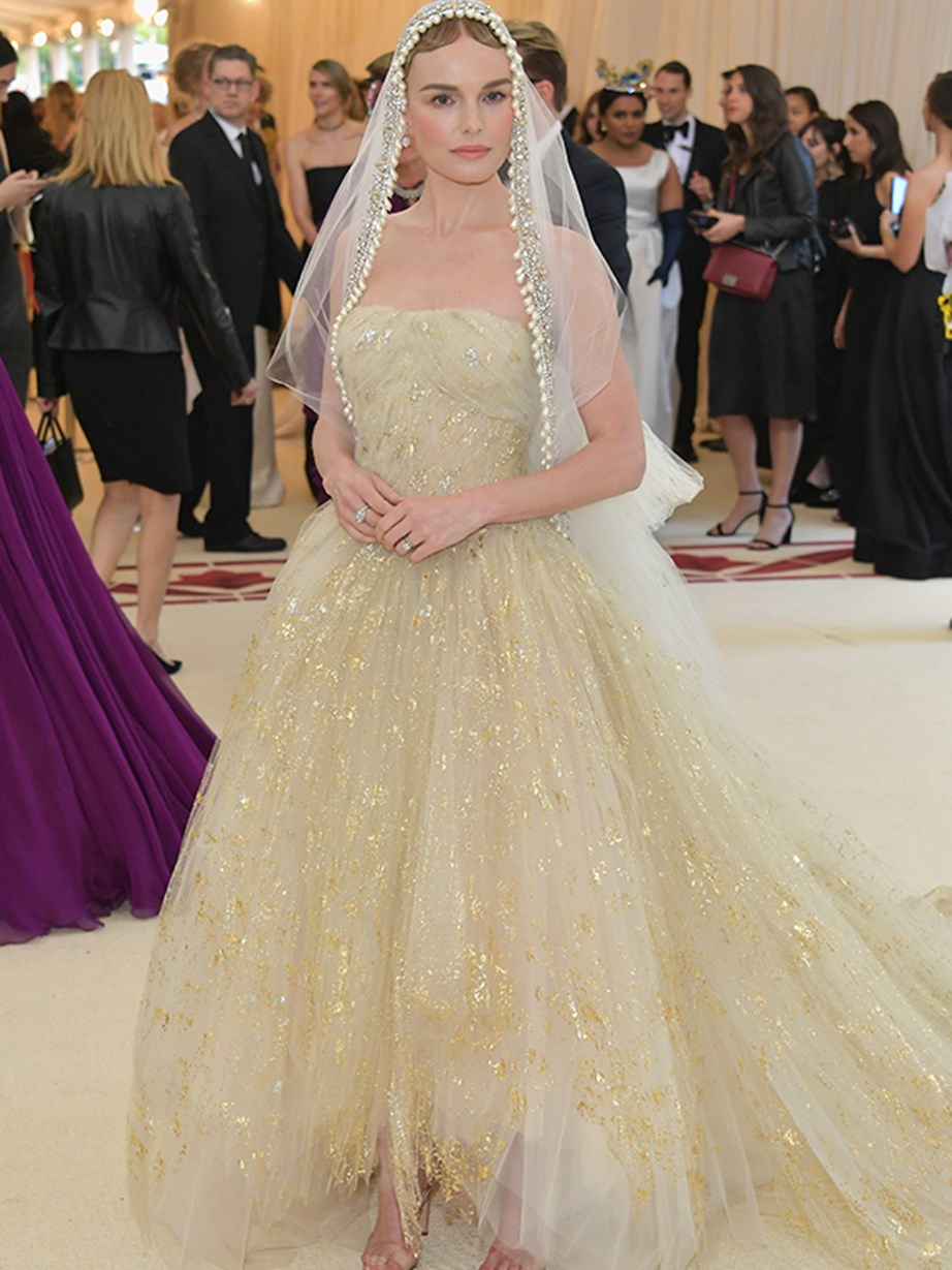 Kate Bosworth looks like a porcelain doll in a stunning champagne gown and veil.