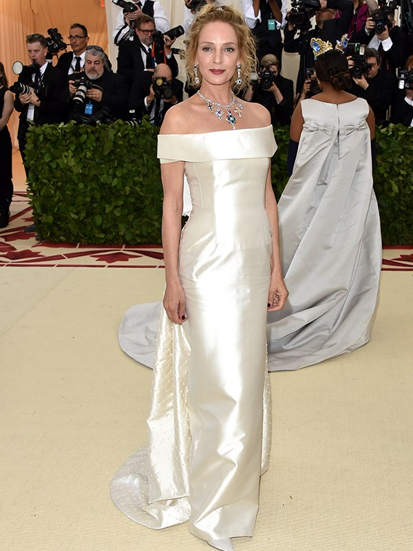 Uma Thurman's jewels sparkle against her white gown.