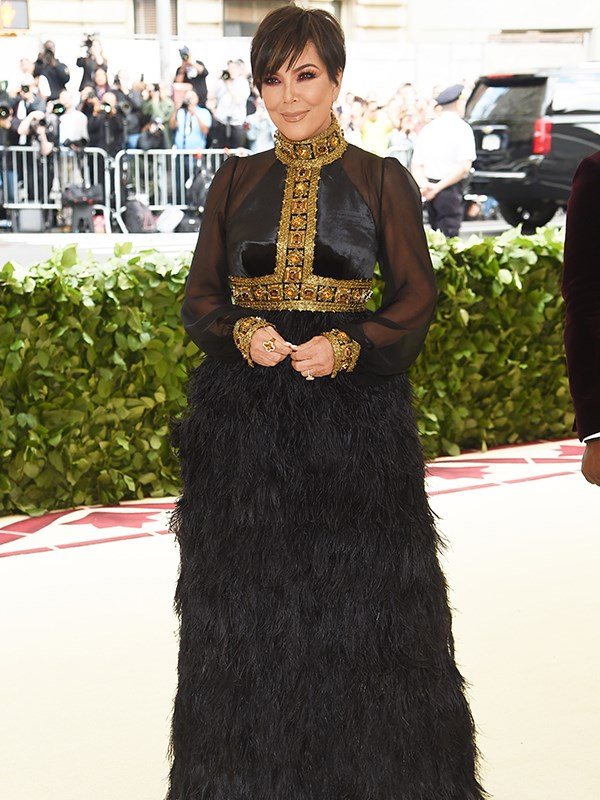 *Keeping Up With The Kardashian*'s matriarch, Kris Jenner, opted for a full-skirt of black feathers.
