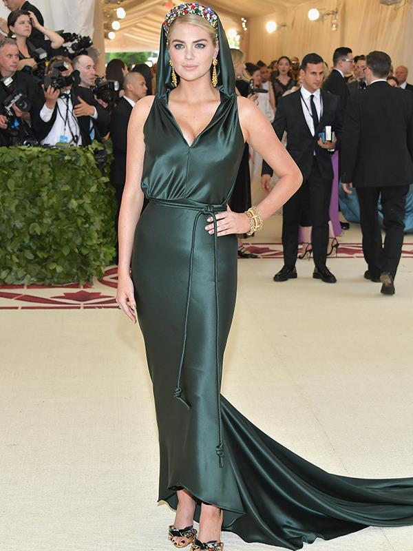 Actress Kate Upton has arrived in a emerald, hooded gown.
