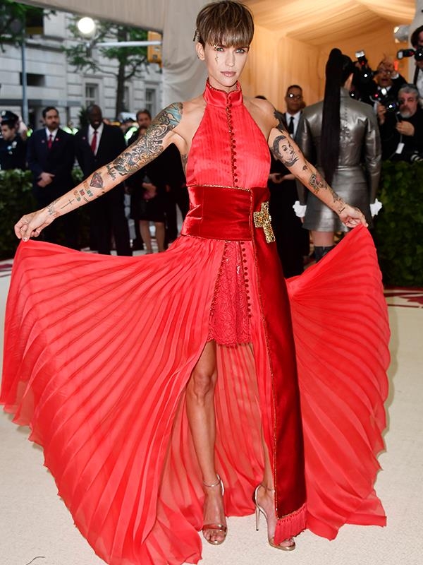 Flying the Aussie flag and flapping her pleated skirt, Ruby Rose rocks it in red.