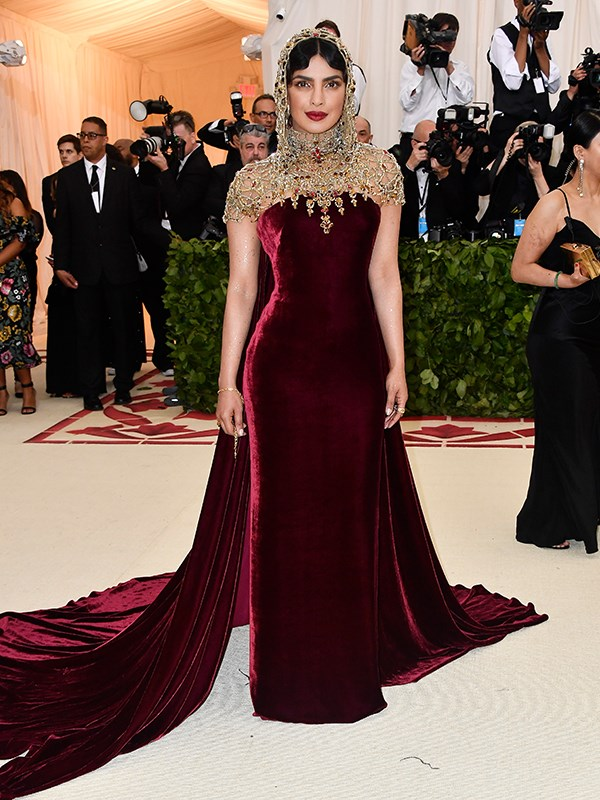 Before attending her longtime friend Meghan Markle's wedding to Prince Harry, actress Priyanka Chopra is the picture of sophistication at the Met Gala.