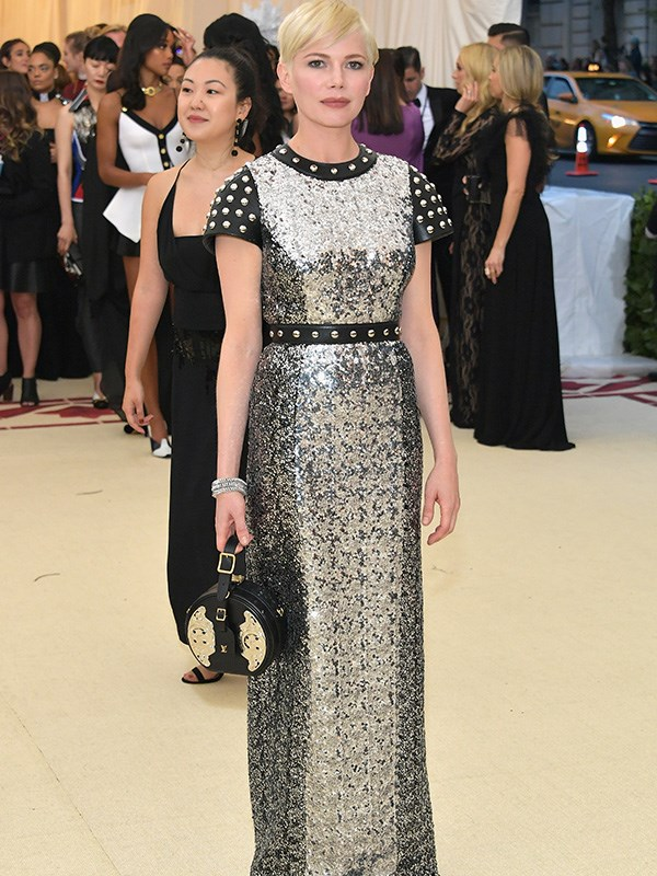 Michele William shines in a sleek sequined gown with studded leather details.