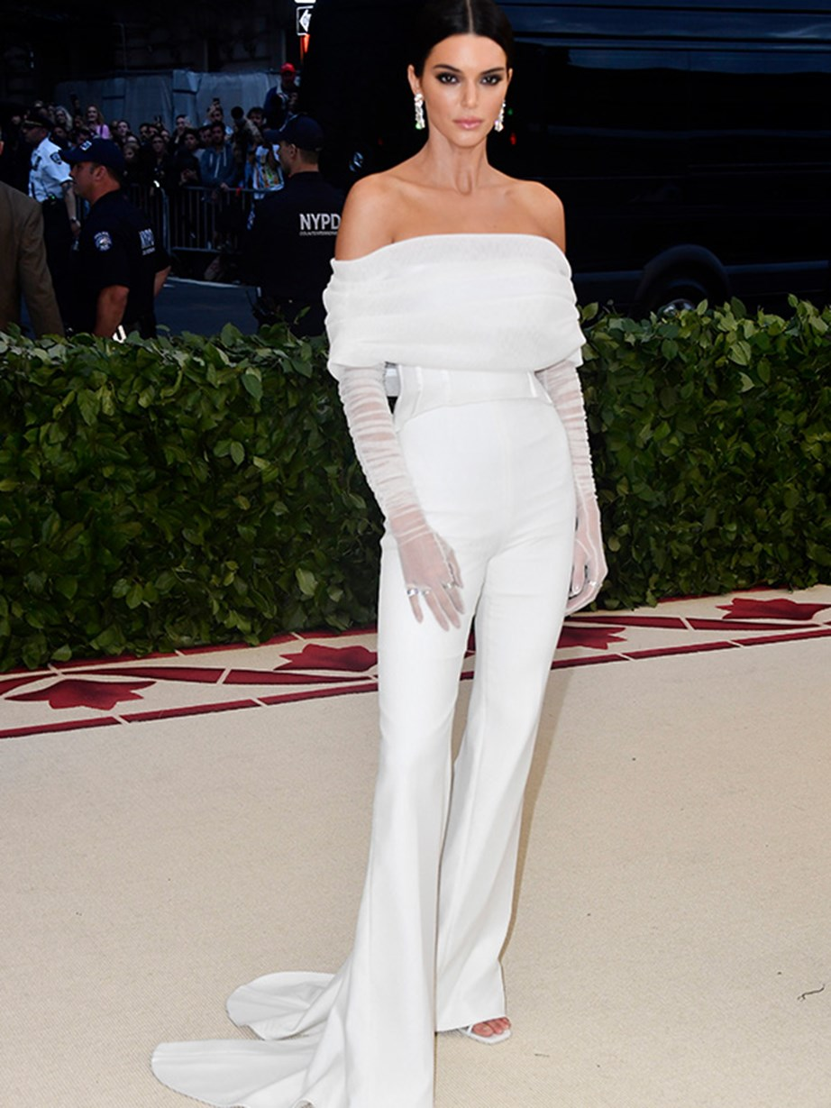Kendall Jenner showed off her incredible figure in fitted white pants and top.
