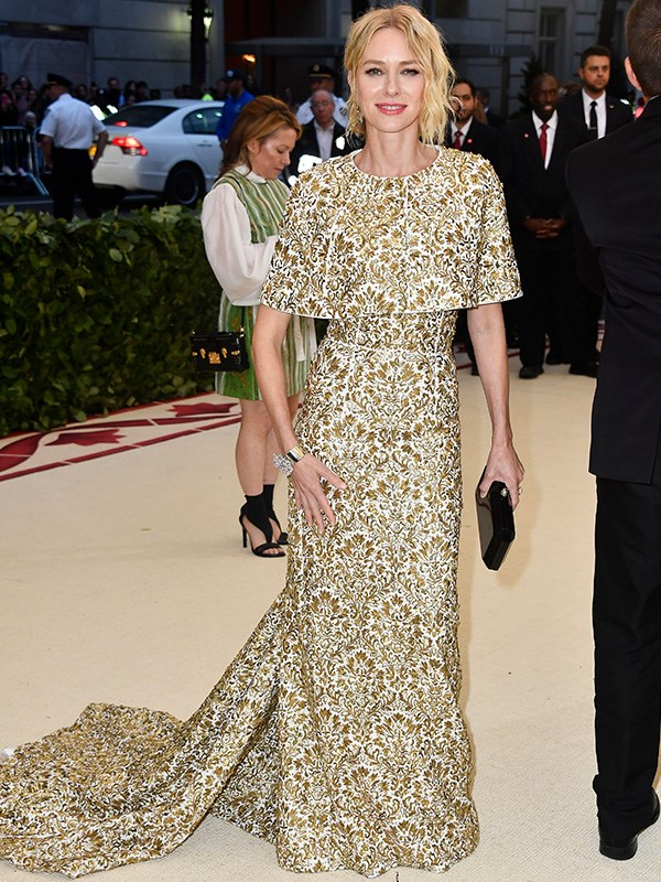Simply stunning! Naomi Watts is a vision in white and gold.