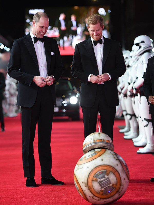 Tee brothers are greeted by droid BB-8 as they arrive for the European Premiere of Star Wars: The Last Jedi in London, 2017.
