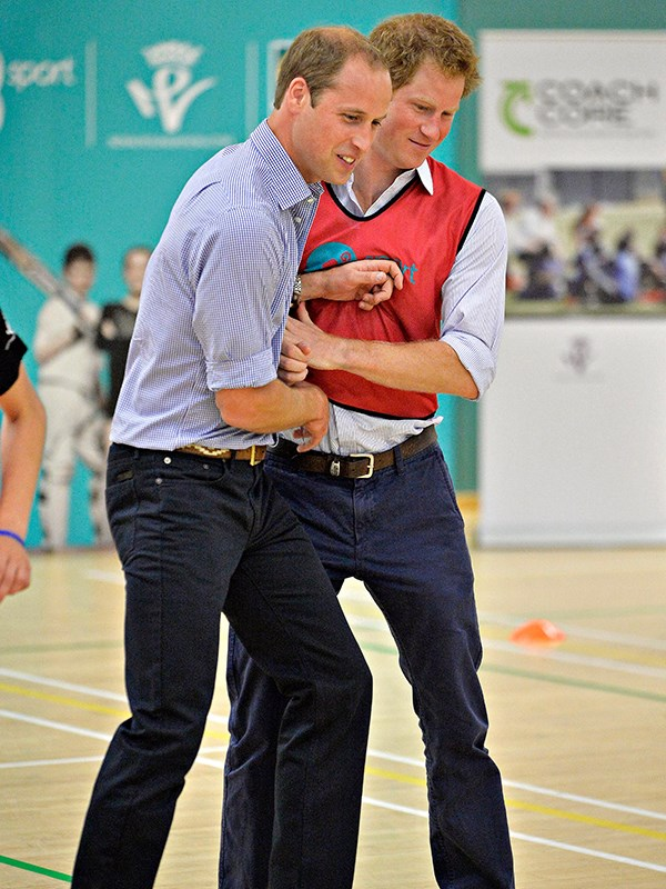 They're competitive! Harry and William play 5 a side football during a visit to the Coach Core project at Gorbals Leisure Centre in Scotland in 2014.