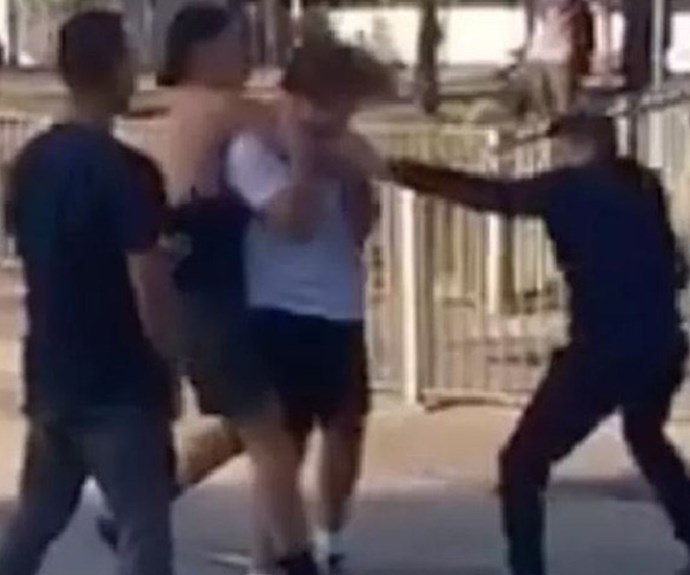 The group of teens pulled Quinn from his bike and attacked him.