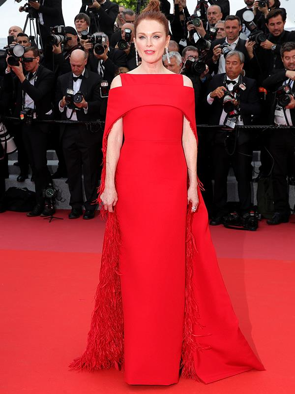 Julianne Moore stuns in a dramatic Givenchy Haute Couture gown with a feathered cape at the premier of *Everybody Knows*.