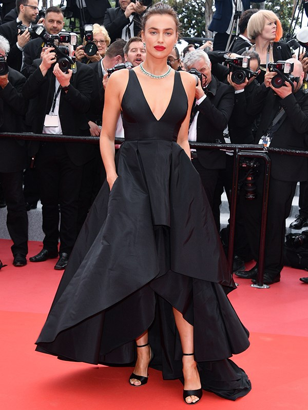 Model Irina Shayk attends the screening of *Yomeddine* in a gorgeous tiered black gown.