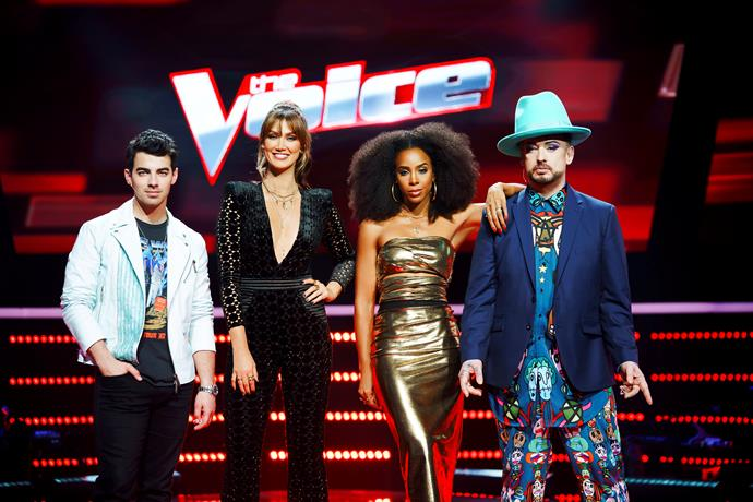 From left to right: Joe Jonas, Delta Goodrem, Kelly Rowland, Boy George star as coaches on *The Voice*.