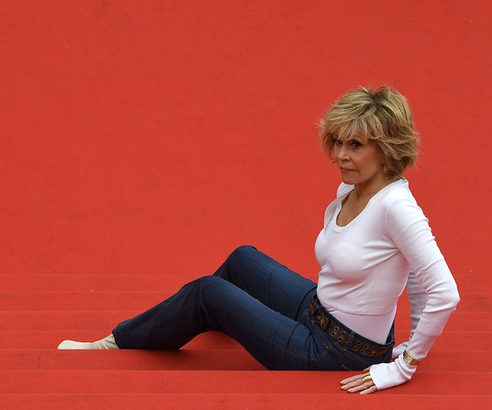 Jane Fonda confused everyone when she sat down on the famous Cannes Film Festival red carpet to do some stretches.