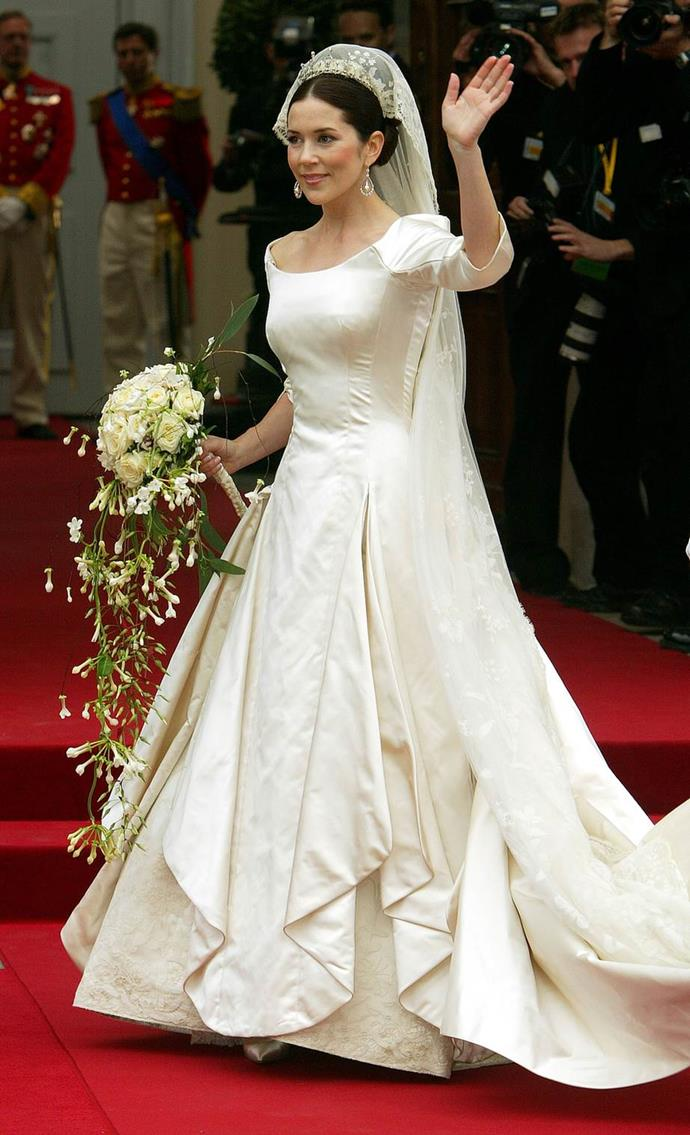 Crown Princess Mary of Denmark's ivory satin gown was created by Danish designer, Uffe Frank. Image: Getty