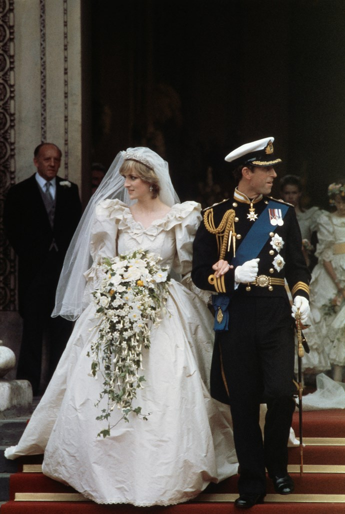 Prince Charles and Diana, Princess of Wales, who wore an ivory silk taffeta and antique lace bridal gown with a 7.62m train. Image: Getty