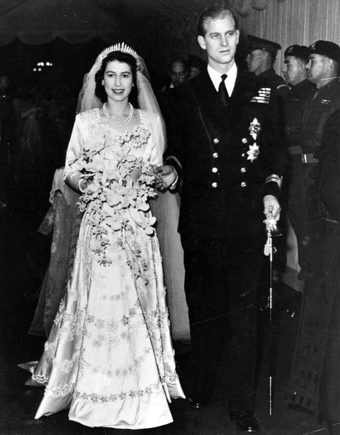 Queen Elizabeth II, as Princess Elizabeth, and her husband the Duke of Edinburgh, styled Prince Philip in 1957, on their wedding day. She became queen on her father King George VI's death in 1952. Image: Getty