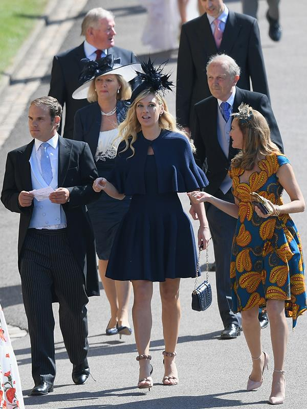 Chelsy looked demure in a short, navy dress.